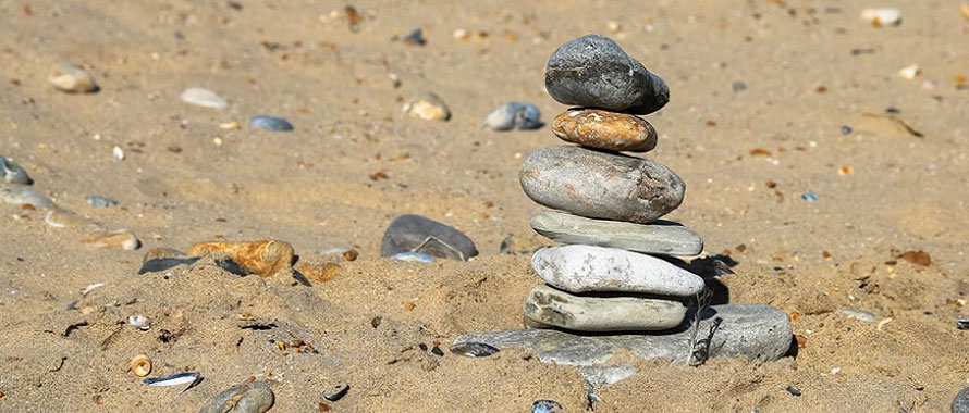 Balanced pebbles on beach: decluttering services South East London